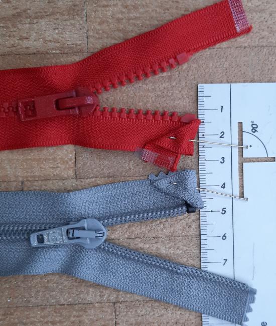 Shorten separating zippers top-end